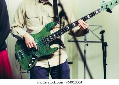 Bass guitar and man