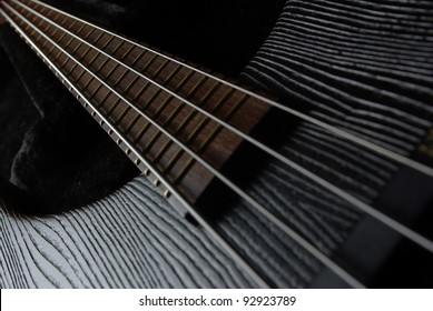 Bass guitar neck on the black