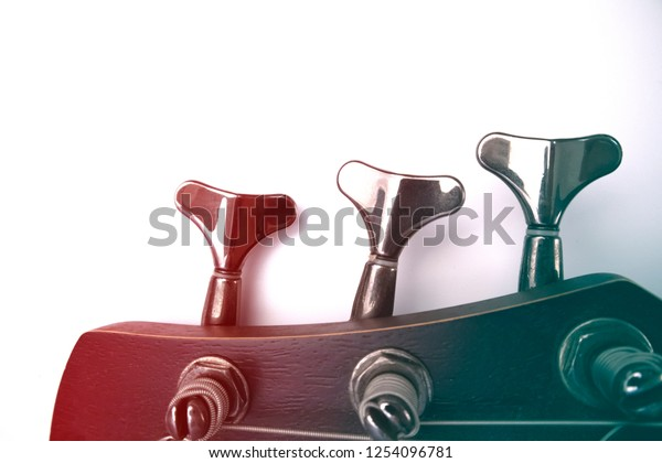 Bass guitar pegs on the head of the neck with gradient effect isolated on white background