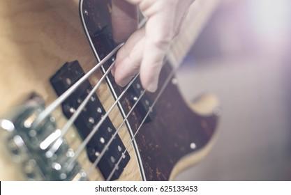 Bass guitar player closeup