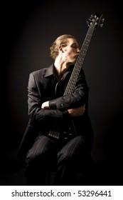 bass guitarist loves his instrument