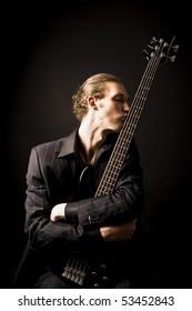 bass guitarist loves his instrumnet