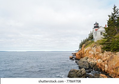 Bass Harbor Head Light and rocky coast at sunrise