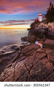The Bass Harbor Head Lighthouse in Acadia National Park, Maine, USA. Photographed at dusk after a spectacular sunset.
