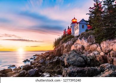 Bass Harbor Head lighthouse at sunset. Bass Harbor Head Light is a lighthouse located within Acadia National Park