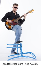 Bass player with attitude playing guitar gently in love with music