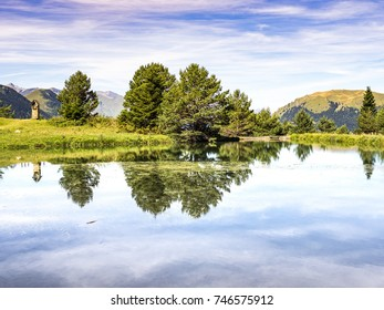 The bassa d'Arres pond reflections in the Aran Valley, Spain