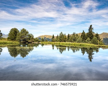 Bassa d'Arres pond reflections in the Aran Valley, Spain