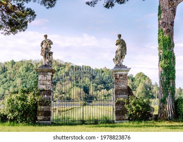Bassano del Grappa, Italy - May 3, 2021: gate with statues from the vineyard of villa Angarano.