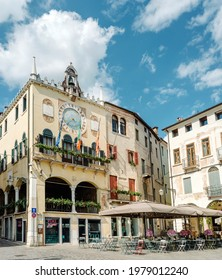 Bassano del Grappa, Italy - May 3, 2021: town hall of the city. Bell tower and astronomical clock located in Piazza Libertà (Freedom square)