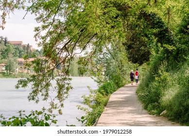 Bassano del Grappa, Italy - May 5, 2021: trails along the Brenta river on a sunny day