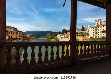 Bassano del Grappa town and the River Brenta seen from the famous Ponte degli Alpini or Ponte Vecchio (Bridge of the Alpini). Vicenza, Veneto, Italy, Europe