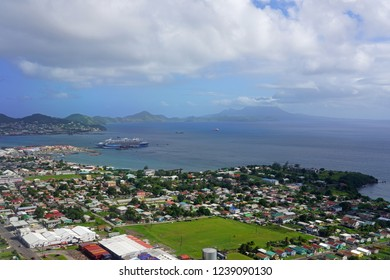 BASSETERRE, ST KITTS AND NEVIS- 17 NOV 2018- Aerial view of two cruise ships in the port of Basseterre in the Caribbean island of St Kitts with a view of the Nevis volcano in the background.