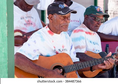 BASSETERRE,ST. KITTS AND NEVIS- APRIL 4,2011: Street musicians playing music at Basetterre streets. Street artist receive an important income from tourist tips at St. Kitts island.