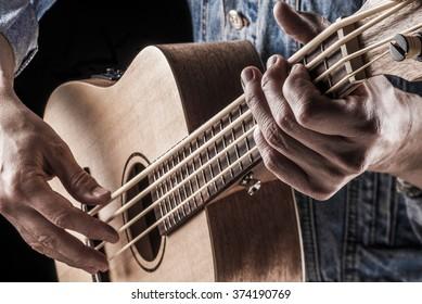 bassist playing ukulele bass