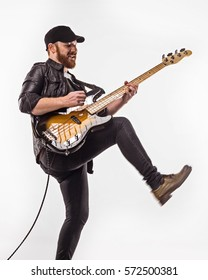 Bassist plays bass guitar. Neutral background