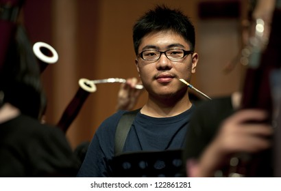 bassoon boy performs on wind music chamber music concert at odeum