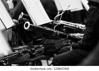 Bassoon in the hands of a musician in an orchestra in black and white closeup