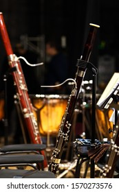 Bassoons standing on stage on stands in dark colors