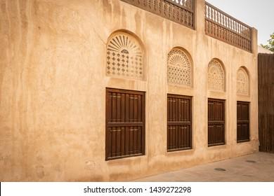 Bastakiya, Dubai,U.A.E.-August 03rd,2018: Traditional wooden windows and airy ventilations in houses in Bastakia quarter.