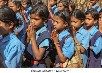 Bastar, December ,20,2011:  Close up of primary school students in blue uniform with school bags line up for morning prayers with devotion  at Bastar, village , Chhattisgarh, India. Asia