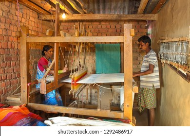 Bastar, December 21, 2011 : Tribal  couple weaving cloth on hand loom  at home  like cottage industry  for their livelihood ,Bastar, Chhattisgarh, India, Asia