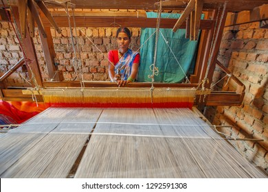 Bastar, December 21, 2011 : Tribal  woman  weaving cloth on hand loom  at home  like cottage industry  for family  livelihood ,Bastar, Chhattisgarh,  India, Asia