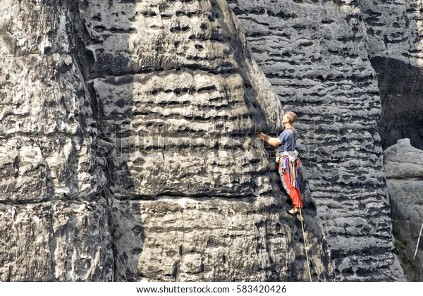 Bastei, Germany, October 29, 2015: One climber on the surface of the mountain