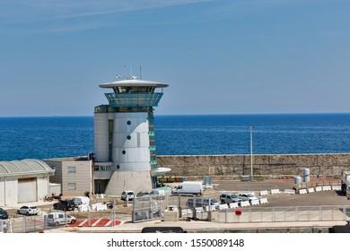Bastia ferry port with modern lighthouse and car parking. Corsica island, France.