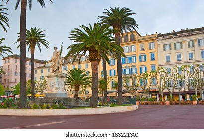 BASTIA, FRANCE - MAY 1, 2013: The monument to Napoleon Bonaparte on General de Gaulle Boulevard is surrounded by scenic flowerbed and palms, on May 1 in Bastia.