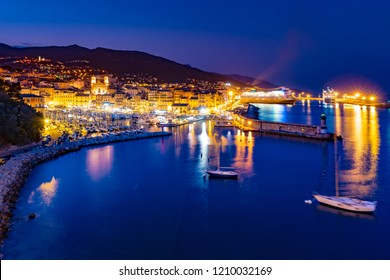 Bastia old city center at night, lighthouse and harbour. Bastia is second biggest town on Corsica, France, Europe.