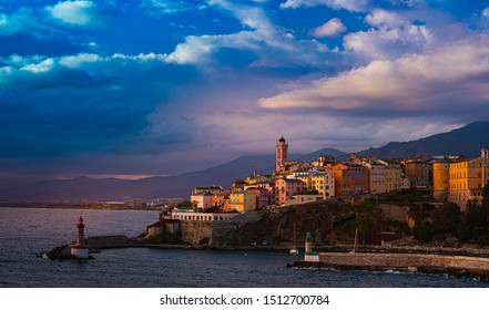 Bastia old city center at sunset, lighthouse and harbour. Bastia is second biggest town on Corsica, France, Europe.