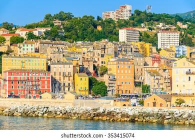 BASTIA PORT, CORSICA ISLAND - JUL 5, 2015: A view of Bastia town on coast of Corsica island, France. Bastia is island's capital and main port.