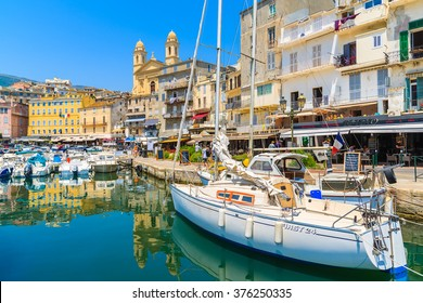 BASTIA PORT, CORSICA ISLAND - JUL 4, 2015: sailing boat in Bastia port on sunny summer day. Corsica is a French island and is very popular holiday destination.