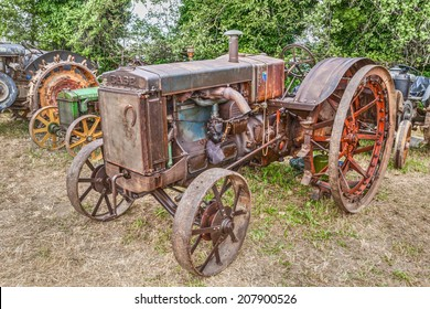 """BASTIA,RA, ITALY - APRIL 26: old american tractor Case C (circa 1930) starting handle, at rally for old tractors during the village fair """"Sagra Paesana Bastia"""" on April 26, 2014 in Bastia, RA, Italy"""
