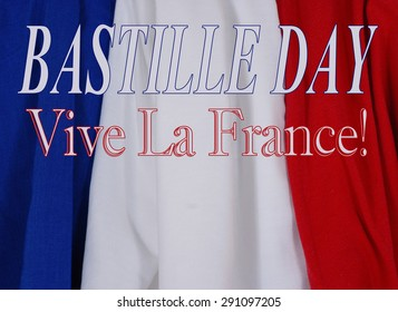 Bastille Day message on draped blue, white and red cloth, creating textured, vertical stripes. Horizontal composition with copy space below French language text message.