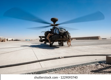 Bastion,Helmend /Afghanistan -Circa 2010 Army Air Corp ground crew re-arm a AH 64 Longbow Apache attack helicopter  British Army Air Corp  during Operation Herrick