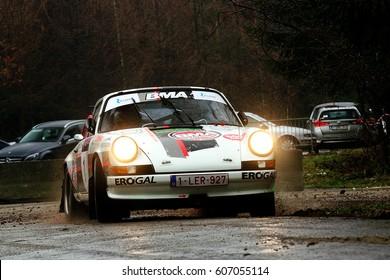 BASTOGNE - FEB 20 : Belgian driver Bernard Munster and his codriver Andree Hansen in a Porsche 911 Carrera RS race in the Legend Boucles a Bastogne 2016, on Feb 20, 2016 in Belgium.
