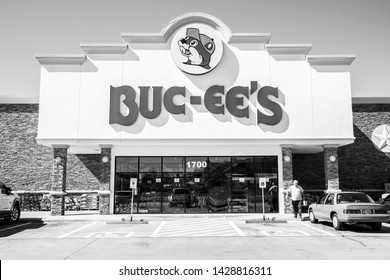 BASTROP, TEXAS - CIRCA MARCH 2019: A Buc-ee's gas station and convenience store is visited by hundreds of hungry patrons on a busy afternoon.