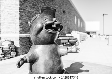 BASTROP, TEXAS - CIRCA MARCH 2019: A Buc-ee's gas station and convenience store is visited by hundreds of hungry patrons on a busy afternoon. The stores feature a bronze beaver statue in the front.