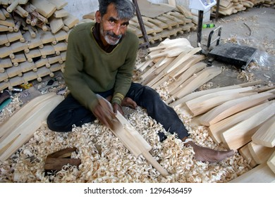 Bat Factory, Jammu and Kashmir, India-April 2018: A man carving a cricket bat from the willow tree.