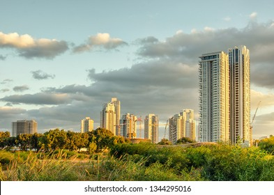 Bat Yam, Israel-December 7, 2017:  A distance view at high rising towers of Bat Yam from the border with Rishon LeTsiyon. Shot in the golden morning hour.
