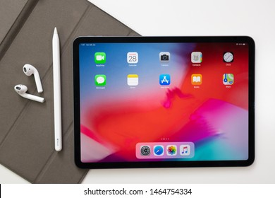 Bat Yam/Israel - July 29, 2019: iPad Pro 11 , AirPods and Apple Pencil on white background.