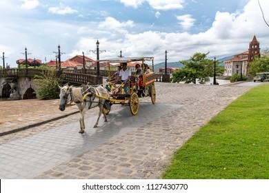 Bataan, Philippines - Jun 30,2018 :Tourists on a wagon at Las casas filipinas