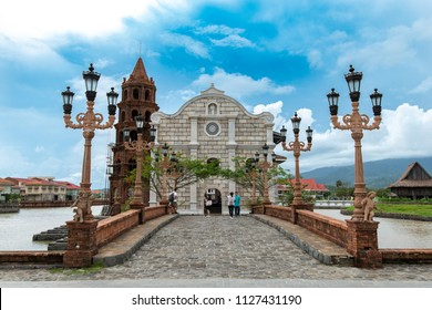 Bataan, Philippines-Jun 30,2018 : Tourists taking pictures in front of the Las casas filipinas cathedral