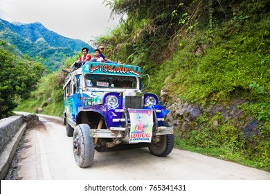 BATAD, PHILIPPINES-MARCH 31, 2016:  Local public transport jeepney driving fast along a mountain road in  province  Banaue on March 31, 2016. Northern Luzon.  Philippines.