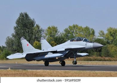 BATAJNICA AIRBASE, SERBIA - AUGUST 29, 2012; RSK MiG-29M2 MiG-35 (NATO code name: Fulcrum) jet fighter interceptor landing with drop tanks under wings after flight