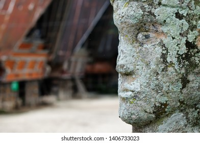 Batak ancient sculptures carved from stoneon of the village in the area of the Toba lake. Samosir Island, Indonesia