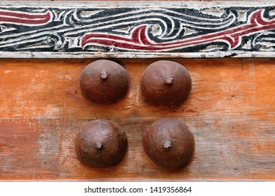 Batak carving on the wall of the village in the area of the Toba lake. Samosir Island, Indonesia