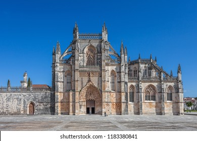 Batalha, Portugal. Monastery of Batalha aka Santa Maria da Vitoria Abbey. Facade with Portal in Gothic and Manuelino aka Manueline style